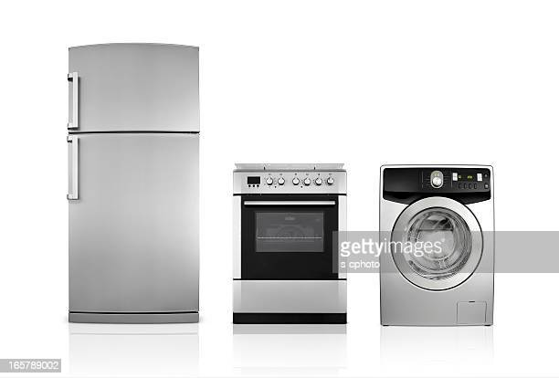 a silver fridge, an oven and dryer lined up side by side - appliance stock pictures, royalty-free photos & images