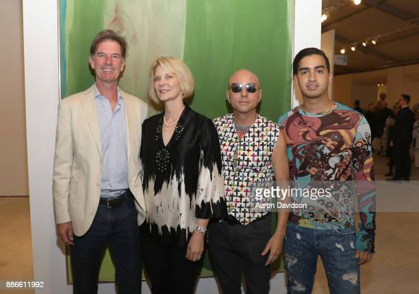 Silver Fritz Wendy Fritz Art Dealer Poet Jimmy D Robinson and Model Christian J Perez attend Art Miami VIP Kickoff at Art Miami Pavilion on December...
