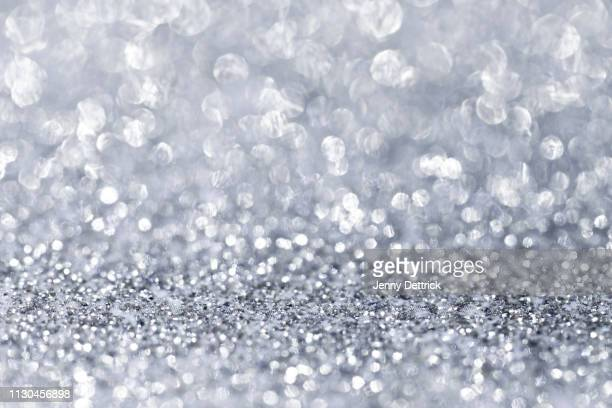 silver glitter background - silver coloured stock pictures, royalty-free photos & images