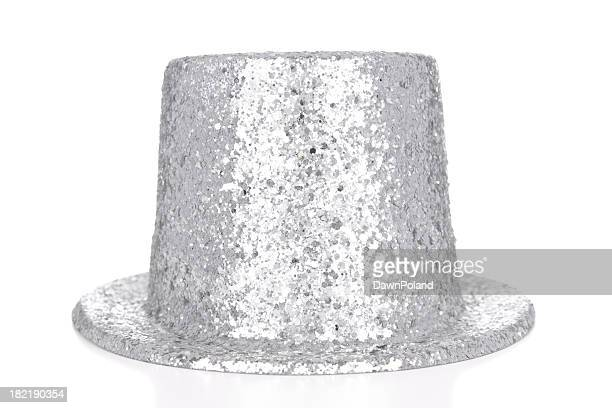 silver glitter top hat on white background - hat stock pictures, royalty-free photos & images