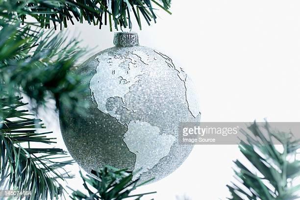 Silver globe bauble on tree