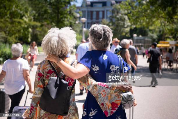 silver haired women touring park in amsterdam - showus stock pictures, royalty-free photos & images
