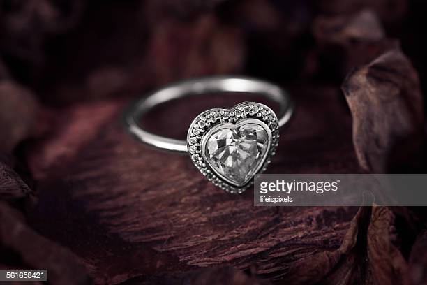 silver heart shaped ring with cubic zirconia - lifeispixels stock pictures, royalty-free photos & images