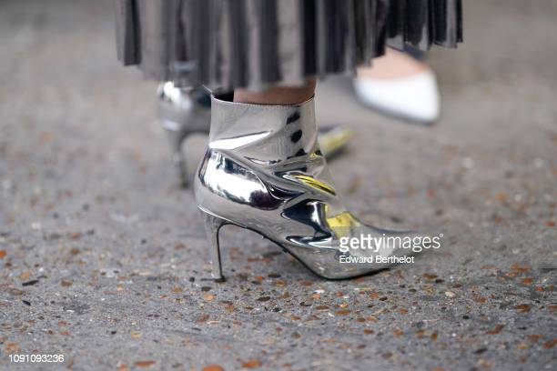 Silver heels shoes are seen during London Fashion Week Men's January 2019 on January 06 2019 in London England