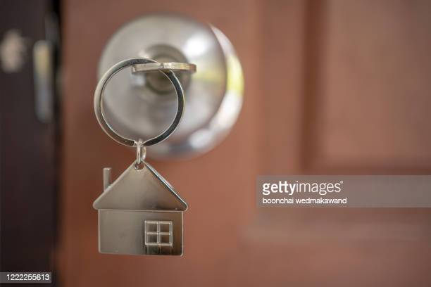 silver house key in a door - second place stock pictures, royalty-free photos & images