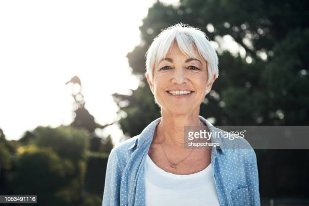 silver in her hair and gold in her heart - white hair stock pictures, royalty-free photos & images