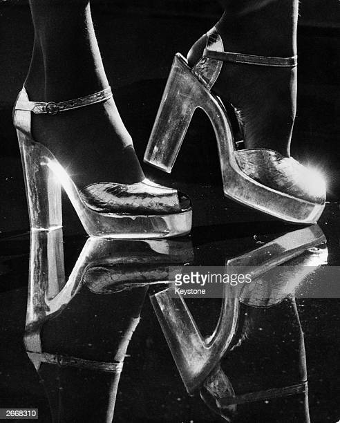 Silver kid platform shoes with perspex heels selling for about 25 Seen at the opening of 'The Chelsea Cobbler' at the 'Way In' Harrods London