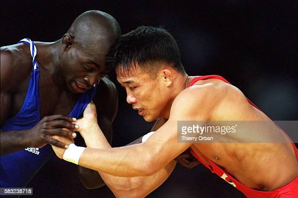 GAMES silver korea cuba games game wrestling game medal olympic olympics olympic olympics gold greco roman