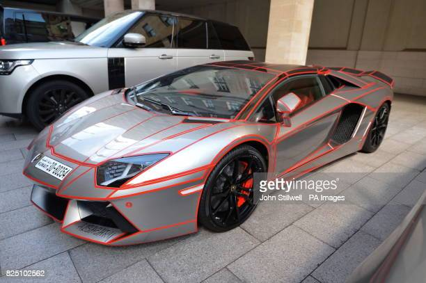 A silver Lamborghini with red stripes and a Kuwait number plate is parked at the Grosvenor House Hotel in London as August see hundreds of Middle...