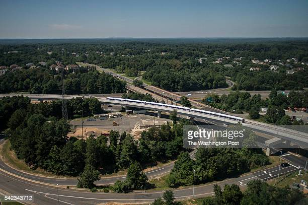 A silver line train runs on its opening day on Saturday July 26 2014 in Reston VA Silver Line adds the first new stations since Morgan Boulevard and...