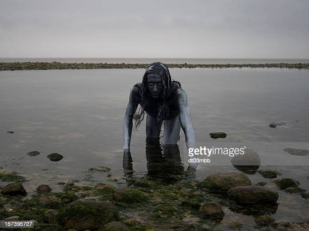 Silver Man Crawling Out of Sea