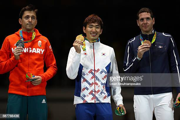 Silver medal Geza Imre of Hungary gold medalist Sangyoung Park of Korea and bronze medalist Gauthier Grumier of France stand on the podium following...
