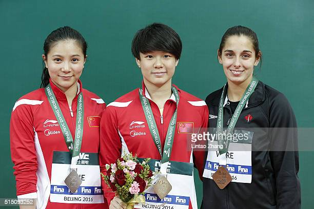 silver medal He Zi gold medal Shi Tingmao of China and bronze Pamela Ware of Canada celebrates after the Women's 3m Springboard Final during day two...