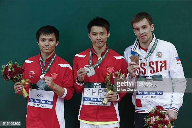 Silver medal Qiu Bo and gold medal Chen Aisen of China bronze medal Victor Minibaev of Russia celebrate after the Men's 10m Final during day three of...