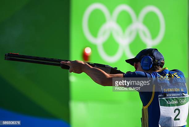 Silver medal Sweden's Marcus Svensson competes during the Skeet men's final at the Olympic Shooting Centre in Rio de Janeiro on August 13 during the...