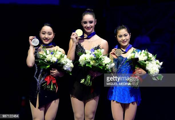Silver medal Wakaba Higuchi from Japan Gold medal Kaetlyn Osmond from Canada and Bronze medal Satoko Miyahara from Japan during the medal ceremony of...