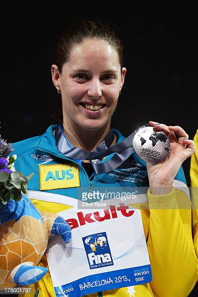 Silver medal winner Alicia Coutts of Australia celebrates on the podium after the Swimming Women's 100m Butterfly Final on day ten of the 15th FINA...