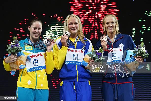 Silver medal winner Alicia Coutts of Australia Gold medal winner Sarah Sjostrom of Sweden and bronze medal winner Dana Vollmer of the USA celebrate...