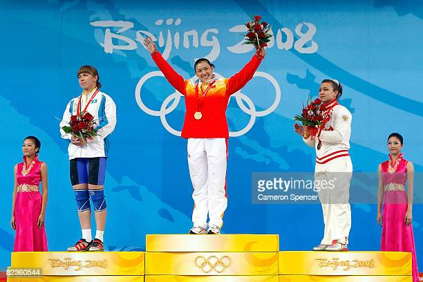 Silver medal winner Alla Vazhenina of Kazakhstan gold medal winner Cao Lei of China and bronze medal winner Nadezda Evstyukhina of Russia stand on...