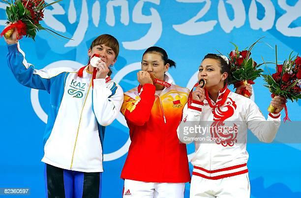 Silver medal winner Alla Vazhenina of Kazakhstan gold medal winner Cao Lei of China and bronze medal winner Nadezda Evstyukhina of Russia kiss their...