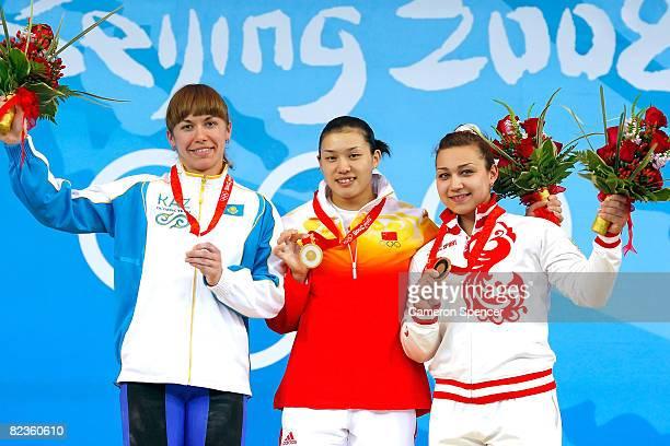 Silver medal winner Alla Vazhenina of Kazakhstan gold medal winner Cao Lei of China and bronze medal winner Nadezda Evstyukhina of Russia hold their...