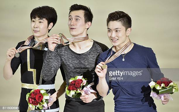 Silver medal winner Boyang Jin of China gold medal winner Patrick Chan of Canada and bronze medal winner Han Yan of China pose for photos after...