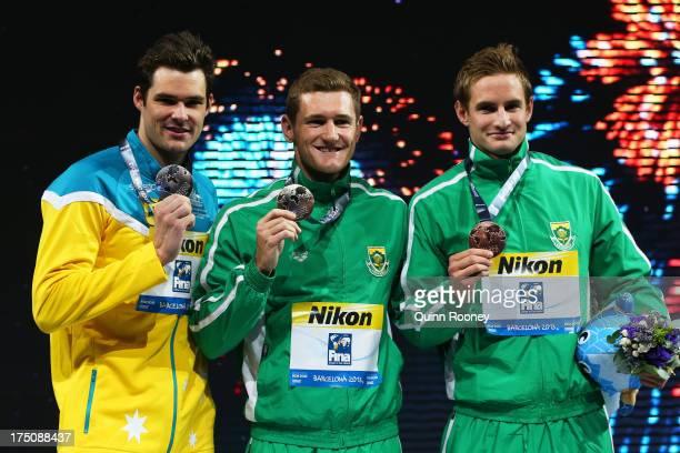 Silver medal winner Christian Sprenger of Australia, Gold medal winner Cameron Van Der Burgh of South Africa and Bronze medal winner Giulio Zorzi of...