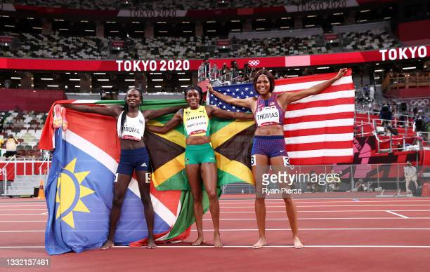Silver medal winner Christine Mboma of Team Namibia, gold medal winner Elaine Thompson-Herah of Team Jamaica and Bronze medal winner Gabrielle Thomas...