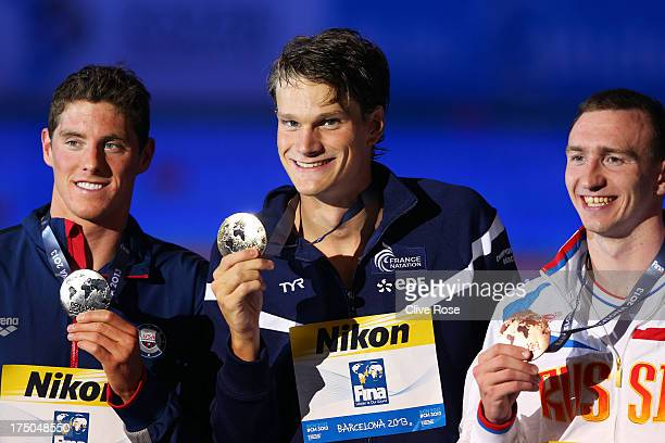Silver medal winner Conor Dwyer of the USA Gold medal winner Yannick Agnel of France and Bronze medal winner Danila Izotov of Russia celebrate on the...