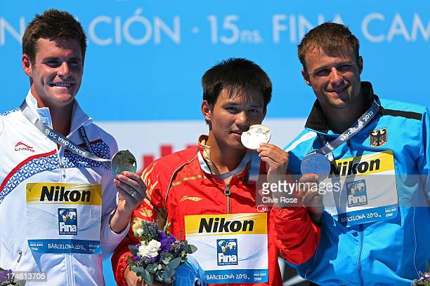 Silver medal winner David Boudia of the USA Gold medal winner Bo Qui of China and Bronze medal winner Sascha Klein of Germany celebrate after the...