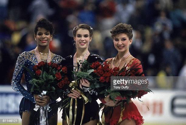 Silver medal winner Debra Thomas of the USA gold medal winner Katarina Witt of East Germany and bronze medal winner Caryn Kadavy of the USA pose for...
