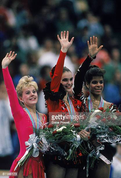 Silver medal winner Elizabeth Manley of the Canada gold medal winner Katarina Witt of East Germany and bronze medal winner Debra Thomas of the USA...