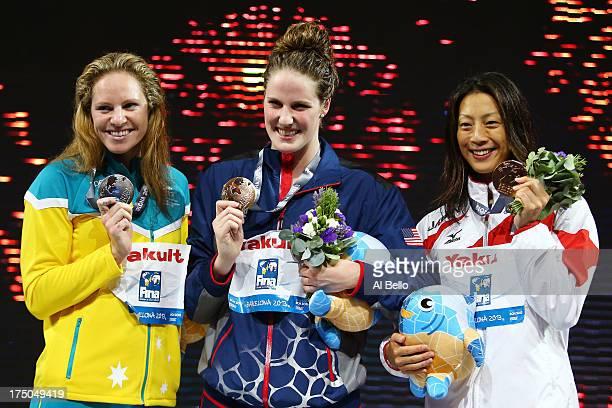 Silver medal winner Emily Seebohm Gold medal winner Missy Franklin of the USA and Bronze medal winner Aya Terakawa of Japan celebrate on the podium...