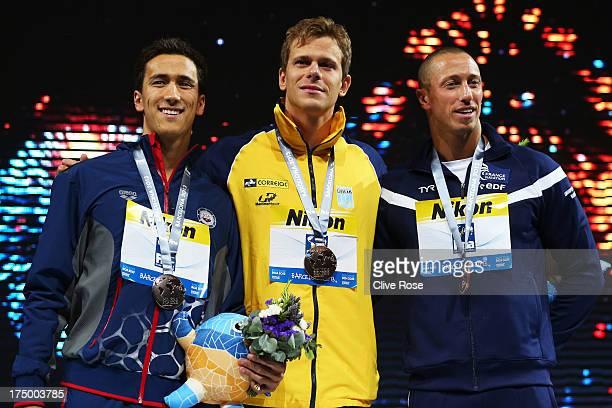Silver medal winner Eugene Godsoe of the USA Gold medal winner Cesar Cielo Filho of Brazil and bronze medal winner Frederick Bousquet of France...