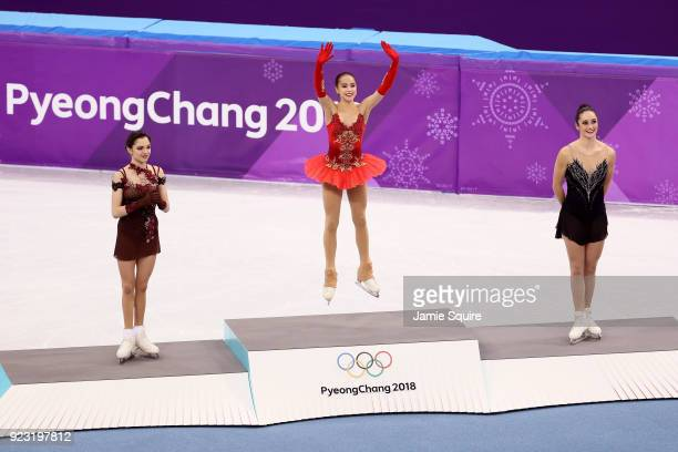 Silver medal winner Evgenia Medvedeva of Olympic Athlete from Russia gold medal winner Alina Zagitova of Olympic Athlete from Russia and bronze medal...