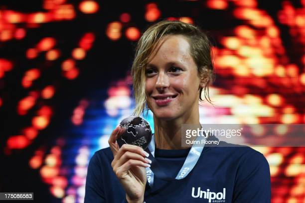 Silver medal winner Federica Pellegrini of Italy celebrates on the podium after the Swimming Women's 200m Freestyle Final on day twelve of the 15th...