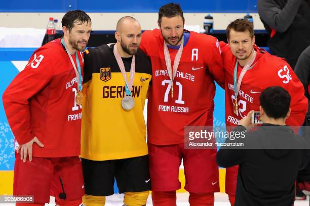 Silver medal winner Felix Schuetz of Germany poses with gold medal winners Pavel Datsyuk Ilya Kovalchuk and Sergei Shirokov of Olympic Athlete from...