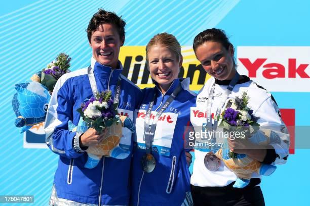 Silver medal winner Ginger Huber of USA Gold medal winner Cesilie Carlton of the USA and Bronze medal winner Anna Bader of Germany celebrate on the...