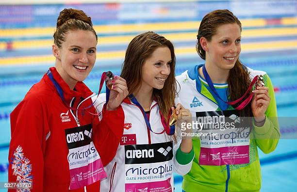 Silver medal winner Jazmin Carlin of Great Britain smiles with Gold medal winner Boglarka Kapas of Hungary and Tjasa Oder of Slovenia in the Women's...