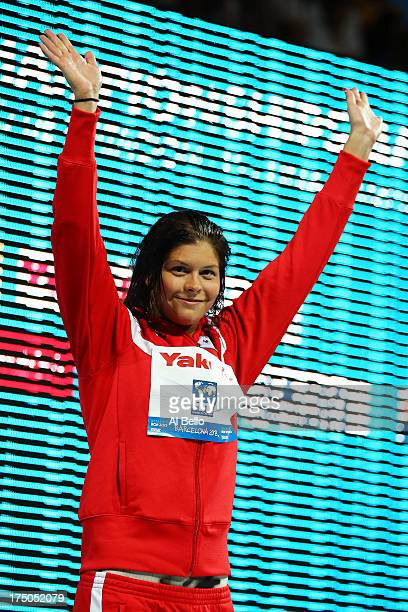 Silver medal winner Lotte Friis of Denmar celebrates on the podium after the Swimming Women's 1500m Freestyle Final on day eleven of the 15th FINA...
