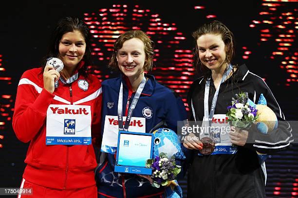 Silver medal winner Lotte Friis of Denmark Gold medal winner Katie Ledecky of the USA and Bronze medal winner Lauren Boyle of New Zealand celebrate...