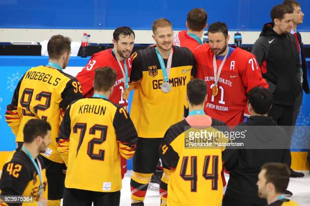 Silver medal winner Moritz Muller of Germany poses with gold medal winners Pavel Datsyuk and Ilya Kovalchuk of Olympic Athlete from Russia after the...
