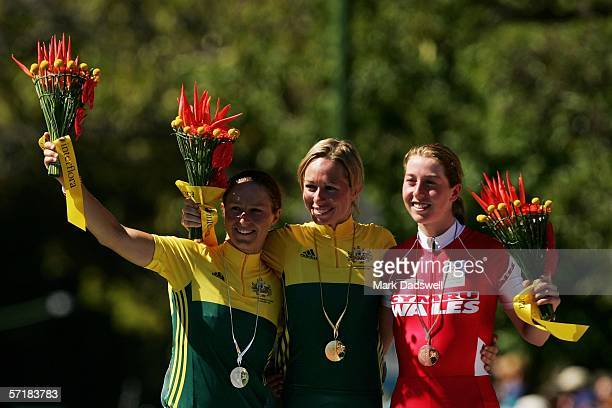 Silver medal winner Oenone Wood of Australia gold medal winner Natalie Bates of Australia and Nicole Cook of Wales wave to the crowd from the podium...