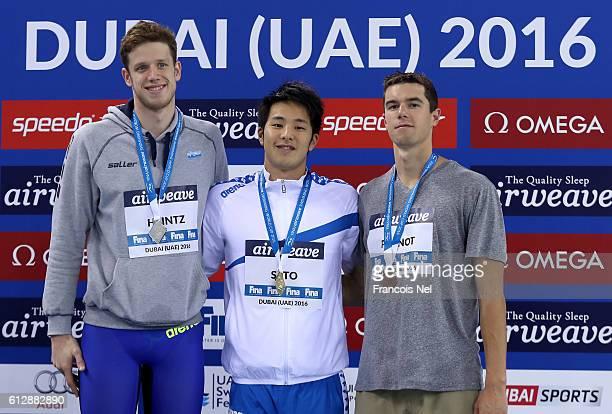 Silver medal winner Philip Heintz of Germany Gold medal winner Daiya Seto of Japan and Bronze medal winner Josh Prenot of USA celebrate on the podium...