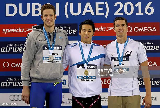 Silver medal winner Philip Heinz of Germany Gold medal winner Daiyso Seto of Japan and Bronze medal winner Josh Prento of USA celebrate on the podium...