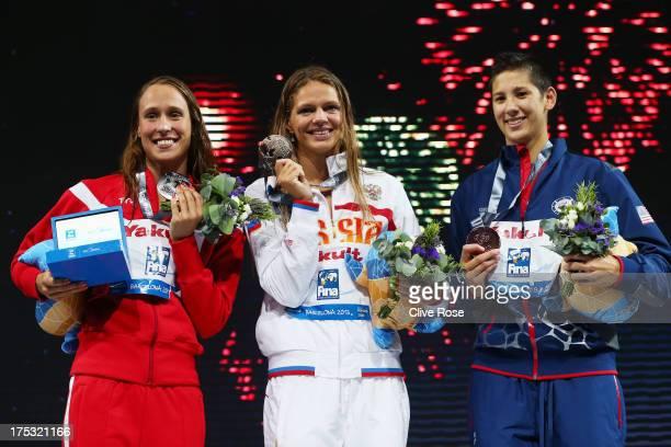 Silver medal winner Rikke Moller Pedersen of Denmark Gold medal winner Yuliya Efimova of Russia and Bronze medal winner Micah Lawrence of USA...