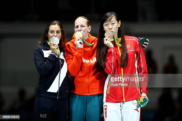 Silver medal winner Rossella Fiamingo of Italy Gold medal winner Emese Szasz of Hungary and Bronze medal winner Yiwen Sun of China pose after the...