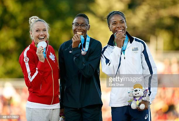 Silver medal winner Sarah Wells of Canada gold medal winner Shamier Little of the United States and bronze medal winner Deborah Rodriguez of Uruguay...
