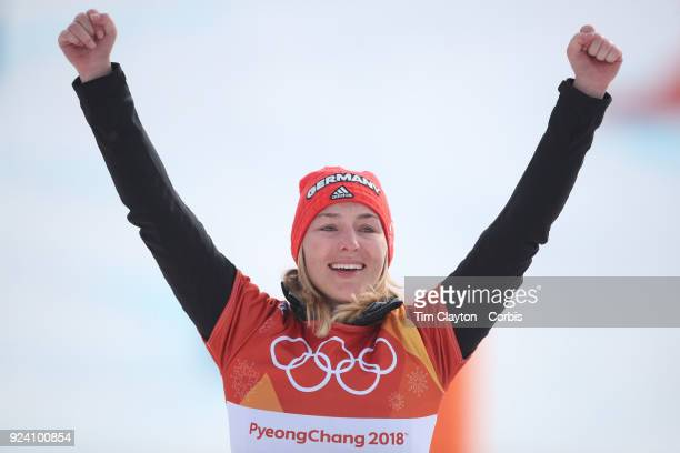 Silver medal winner Selina Joerg from Germany celebrates on the podium after the Ladies' Snowboard Parallel Giant Slalom competition at Phoenix Snow...