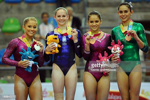 Silver medal winner Shawn Johnson of the United States gold medal winner Bridgette Carquatto of the United States and bronze medal winners Marisela...